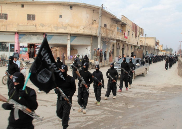 ISIS militants march in Syria in 2014.