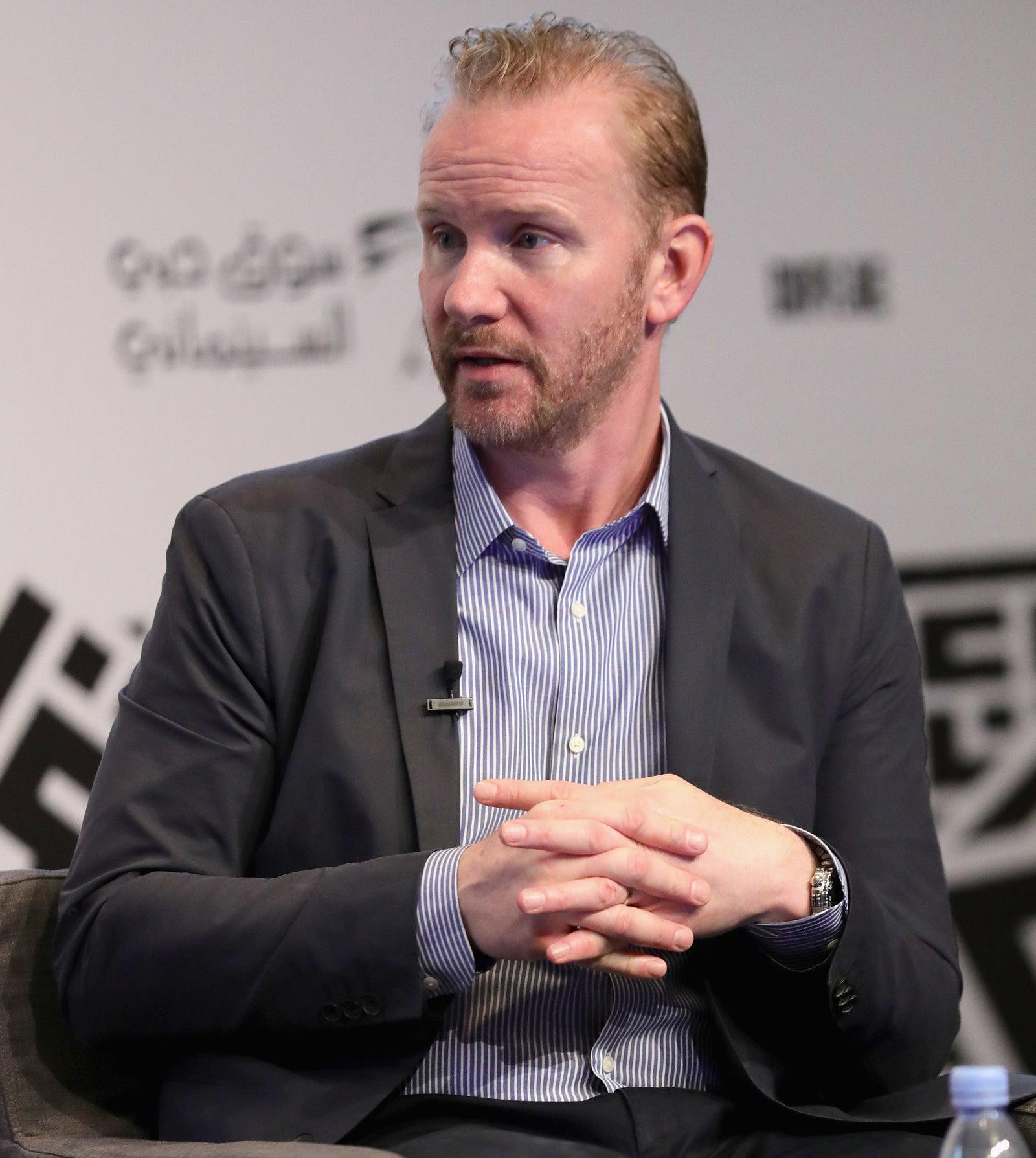 Morgan Spurlock speaks on stage during the 14th annual Dubai International Film Festival held at the Madinat Jumeriah Complex, Dec. 11, 2017.