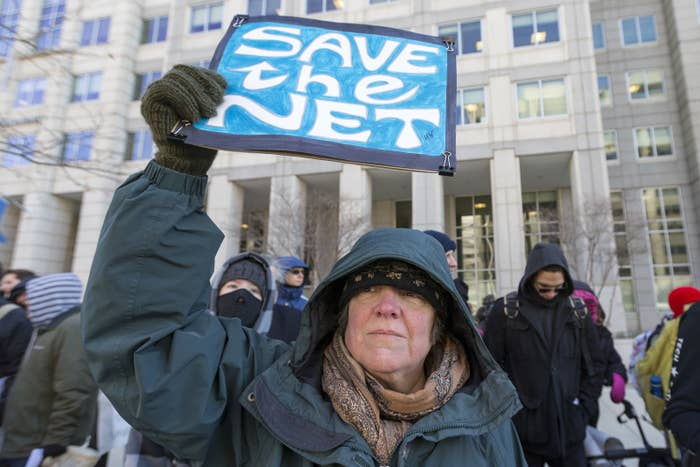 A woman protests the repeal of net neutrality outside the Federal Communications Commission headquarters in Washington, DC, on Dec. 13.