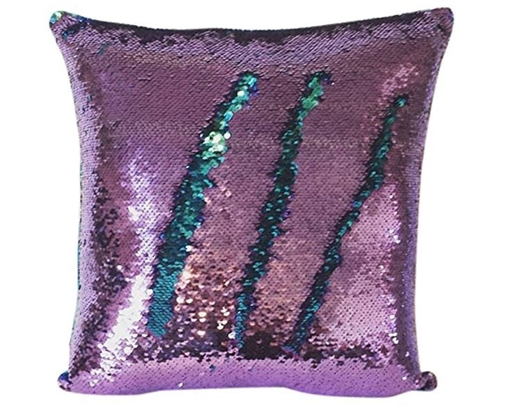 the pillow showing purple sequins with teal ones popping through underneath