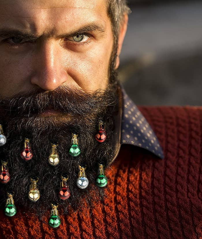 """Promising review: """"Just what I was looking for! No these aren't high-end glass ornaments. But come on, you're gonna use them once? Twice? And the price! This Christmas, my beard will be extra festive (the past two I've done glitter...too messy!) These are perfect."""" —N. SandsGet a pack of 12 from Amazon for $11.99."""