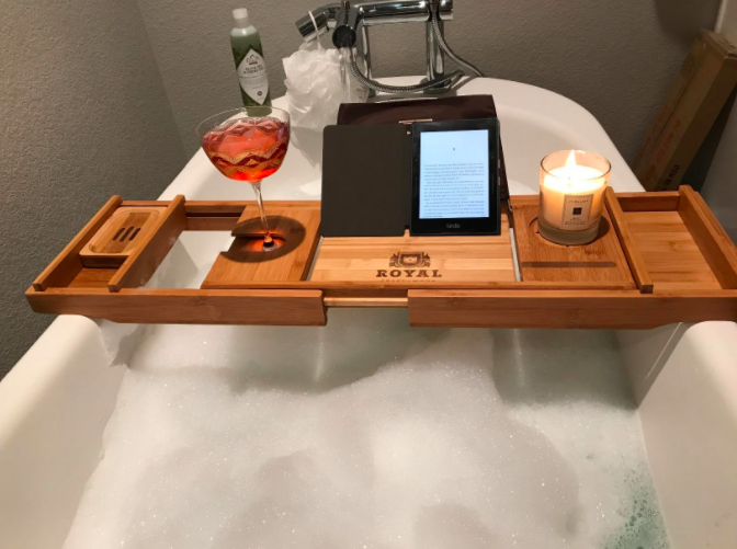 """Because spilling a little wine in your bubble bath is a risk you no longer have to take.Promising review: """"This bathtub tray stretches across my large bathtub without a problem! It's great for holding up my tablet and a place to rest my glass while taking a bath. Used it several times in the last few months and it is as good as new. Great quality material and I'm sure it will last for quite some time."""" –T. ThumbGet it from Amazon for $49.97."""