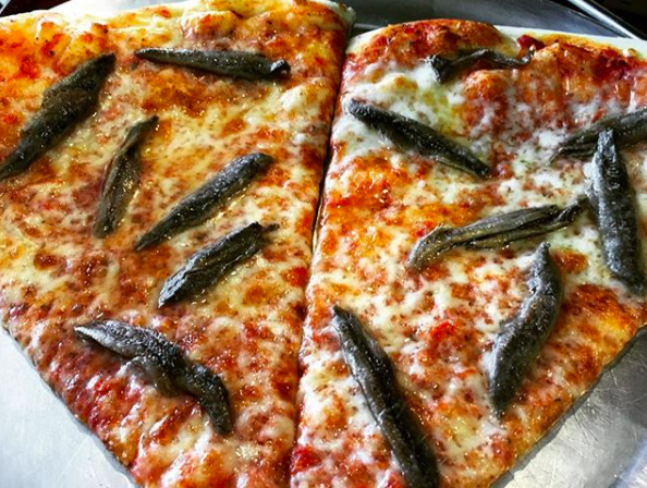 This pizza that has been taken over by anchovies.