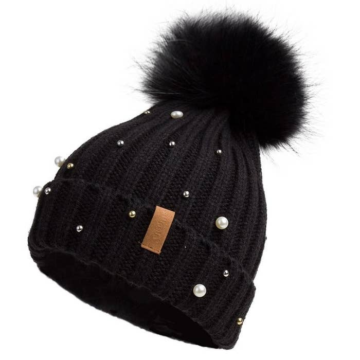 fde2a891061 A pearl-embellished beanie comeplete with faux fur pompom