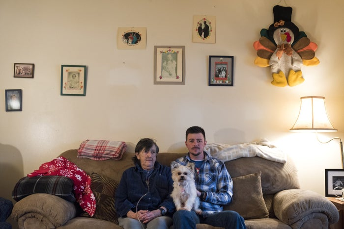 Talbott with his grandmother, Rhoda Dineen, 70, and their dog, Lily, in their living room.