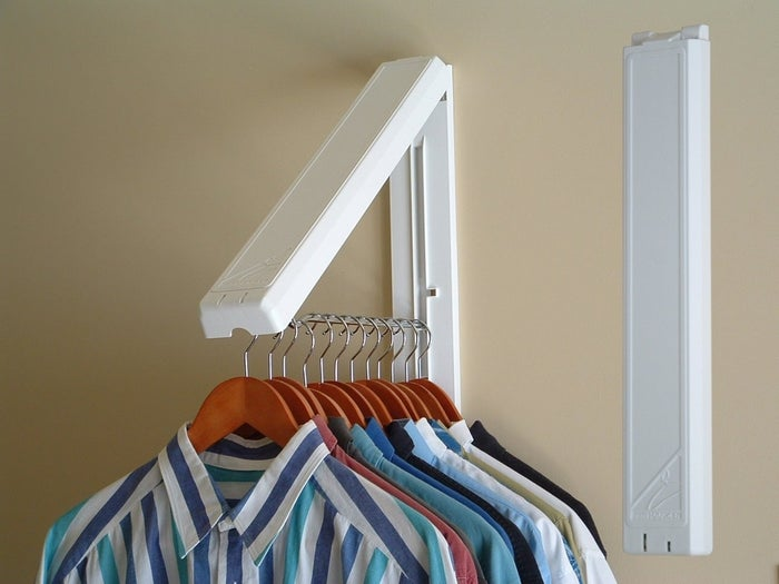 "The InstaHanger installs into any wall and rests flat against the wall when not in use. When open, it allows 12 inches of hanging space. It can to hold up to 60 pounds of clothes, making it perfect for drying delicates in a laundry room or hanging extra coats when you have guests. Promising Review: ""This is a great way to provide temporary hanging space. The hanging bar is a foot long and doesn't seem to mind the weight of any clothes I've hung up (including heavy jeans). It folds away discreetly against the wall when not in use. It installs with two screws. You can use a wall anchor (two kinds provided) if you aren't screwing into a stud. I've had my first one for a year; just bought an additional one."" —MaryKPrice: $16"
