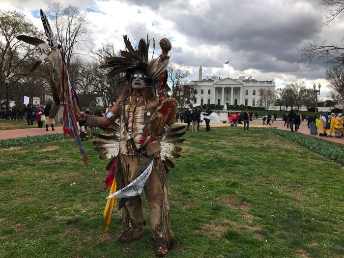 A medicine man dances in front of the White House at a rally for Native American rights on March 10, 2017, in Washington, DC.