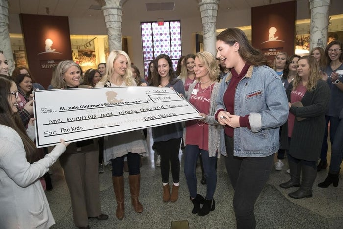 """Messina was also able to meet a fellow college student and St. Jude patient, Madison, in person at the check presentation. The two connected over Twitter shortly after her story went viral. """"She's an inspiring young women,"""" Jennifer Godwin, the public relations liaison for ALSAC, said of Messina and her efforts. """"It's really impressive."""""""