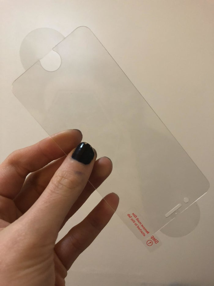 A few years ago when I was pickpocketed in an awful tourist bar in New Orleans, I was especially salty when I had to *deal* with the terror of replacing my phone. I had insurance but the overall experience was still annoying, particularly when I was hoodwinked into paying $30 for a screen protector at the Apple Store. I've become even saltier about the experience since discovering that you can pay $7.99 for two —TWO — of those screen protectors on Amazon. So when I upgraded to a new phone in November, I bought them to install myself. It was a total snap to apply and took about maybe 10 minutes of my time, between opening the packaging, running the shower in my bathroom to help eliminate lint in the air (per the instructions), and actually placing it on the phone. There are well-marked directions and tabs that make perfect placement easy, even if you're super nervous about gadgety stuff like I am. These protectors are as tough as if not tougher than my old protector. And the customer photos and reviews on Amazon show that they keep phone screens intact in extreme conditions, like getting dropped on a Grand Canyon hike and being run over by a car. I'm not going to *try* to test it in these ways, but if something happens to my current screen protector, I have a replacement at the ready! —Elizabeth LillyGet a two-pack from Amazon for $7.99.