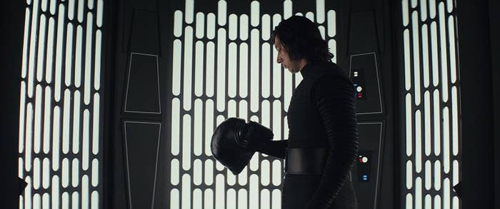 Kylo Ren examines his helmet (before punching a wall with it) in The Last Jedi.