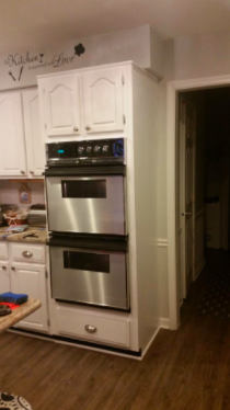 same reviewer's after pic with the ovens in the stainless steel look