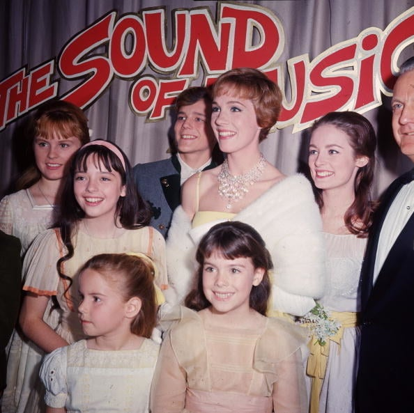 The cast of The Sound of Music at the film's 1965 premiere, with Menzies-Urich on the far-left side.