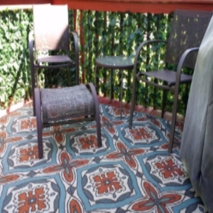 reviewer pic of deck with the faux ivy wrapped on the railing to obscure the view below