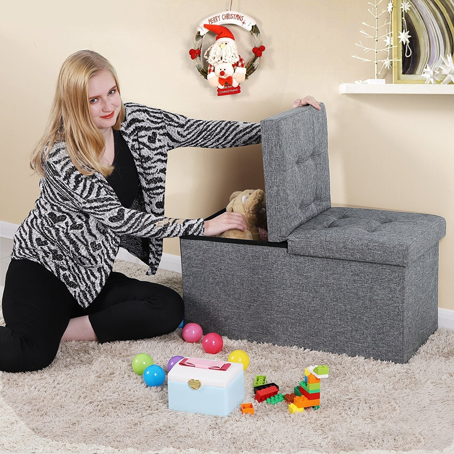 person putting toys into a storage ottoman