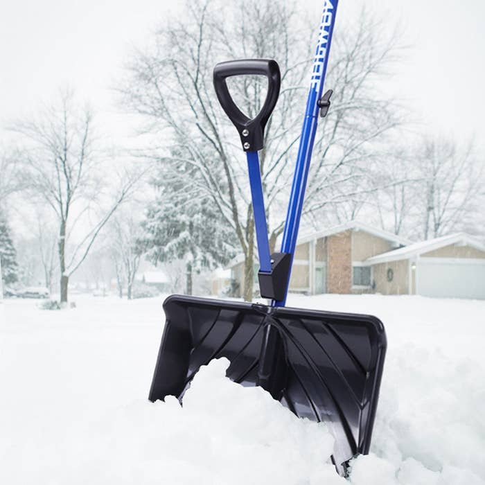 """Promising review: """"It saves me from bending over for snow. The shovel tosses snow easily (6' or more, I couldn't do that with the old shovel). I'm over 6' and only have to bend down slightly with the short handle on the Snow Joe, which is much less than the older shovel. The metal piece on the bottom helps scrape the patio and solid walkways. Also, the shovel pushes into wind-packed snow pretty well. If you're working with brick-like snow drifts, try slicing from the top and scooping out at a near-90-degree angle to the ground. Forget trying to lift out pieces of it until you break through the brick-like snow. It's light weight. The wiggly second handle takes some getting used to. Snow didn't stick to this shovel and it worked fine for light fluffy snow, powdery wind packed snow, and frozen brick-like snow. Whether it was -10 F or 20 F, snow didn't stick and slid off easily."""" —Goof Ball Get it from Amazon for $20.38."""