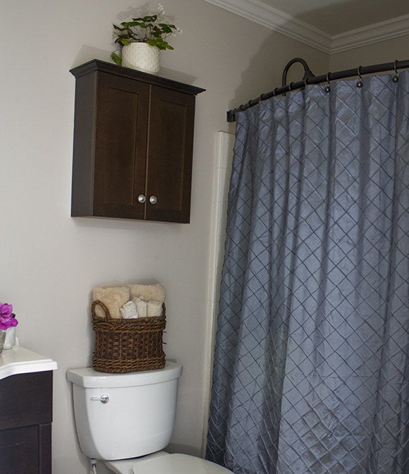 Choose a curved curtain rod to make your shower way more spacious.