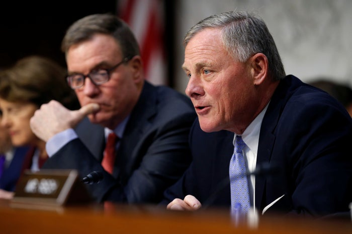 Senate Intelligence Committee Chair Richard Burr speaking at a Senate hearing alongside Vice Chair Mark Warner.