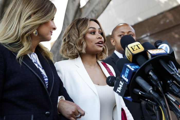 Blac Chyna, center, speaks while standing with her attorneys Lisa Bloom, left, and Walter Mosley outside a Los Angeles courthouse on July 10.