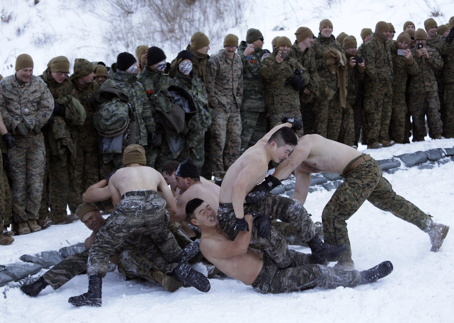 South Korean and US Marines have a wrestling match during their joint military winter exercise in Pyeongchang, South Korea, on Dec. 19.