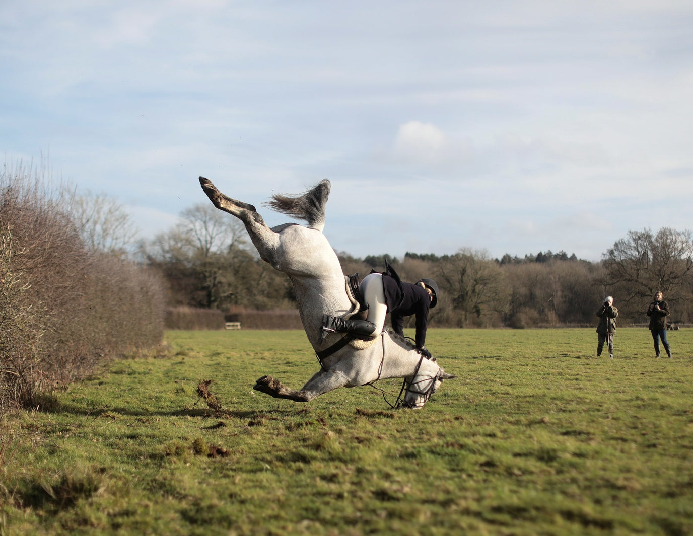 A huntswoman crashes as she jumps a fence during the annual Boxing Day hunt in Chiddingstone, Britain, on Dec. 26.