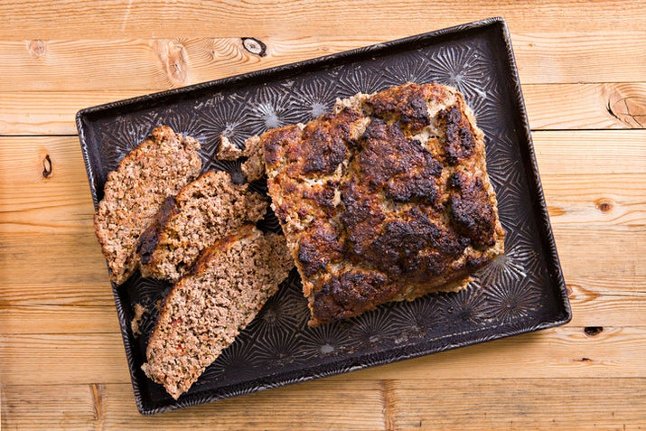 """Stop putting meatloaf into loaf pans. It traps all the grease and fat and makes it soggy. Form a free loaf on a baking sheet so everything drains away and the meat can actually get nice and browned."" —blackzephyr"