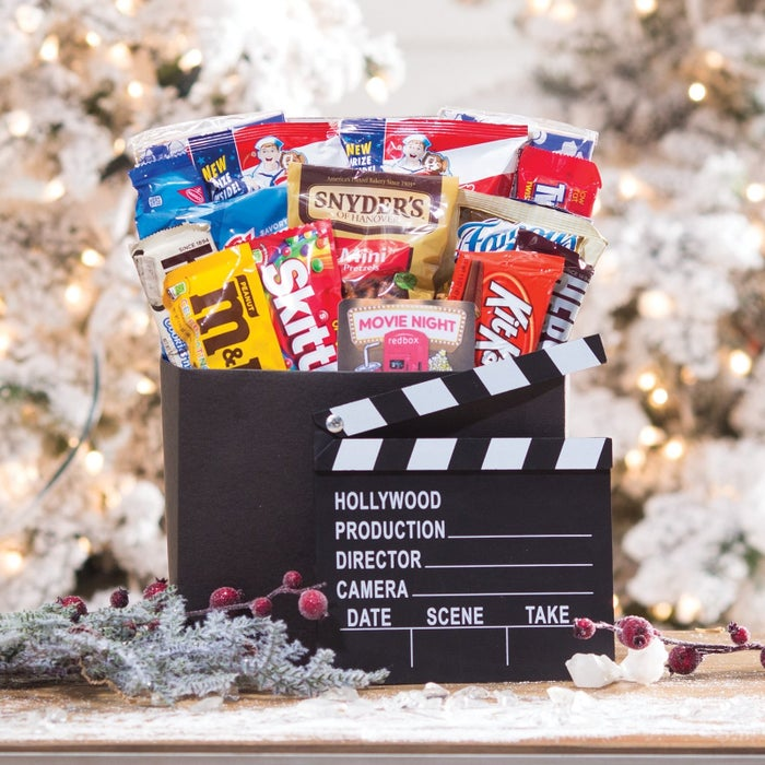 This cinematic set includes two microwave pop-up popcorn bowls, a bag of Skittles, two bags of Cracker Jacks, a mini bag of Chex Mix, a Twizzlers packet, Kit-Kat bar, Chocolate bar, Raisinettes box, two boxes of M&M's (plain and peanut), a mini bag of Famous Amos chocolate chip cookies, a bag of Snyder's pretzels, an Oreo cookies packet, a Red Box gift card (worth six movie rentals), and that snazzy director's chalkboard.Price: $62.99