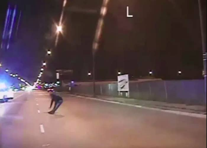 In this still image taken from a police vehicle dash camera released by the Chicago Police Department on Nov. 24, 2015, Laquan McDonald falls to the ground after being shot by Chicago Police Officer Jason Van Dyke.