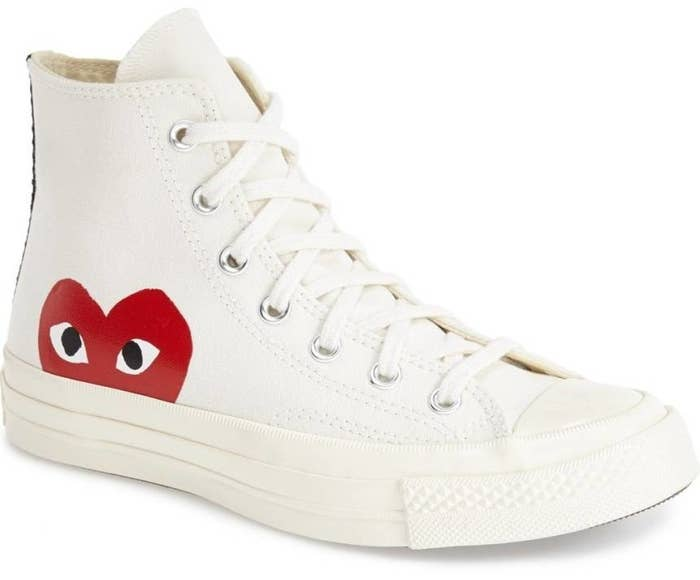b825a3376401 A pair of Comme des Garcons Play x Converse Chuck Taylor high-top sneakers