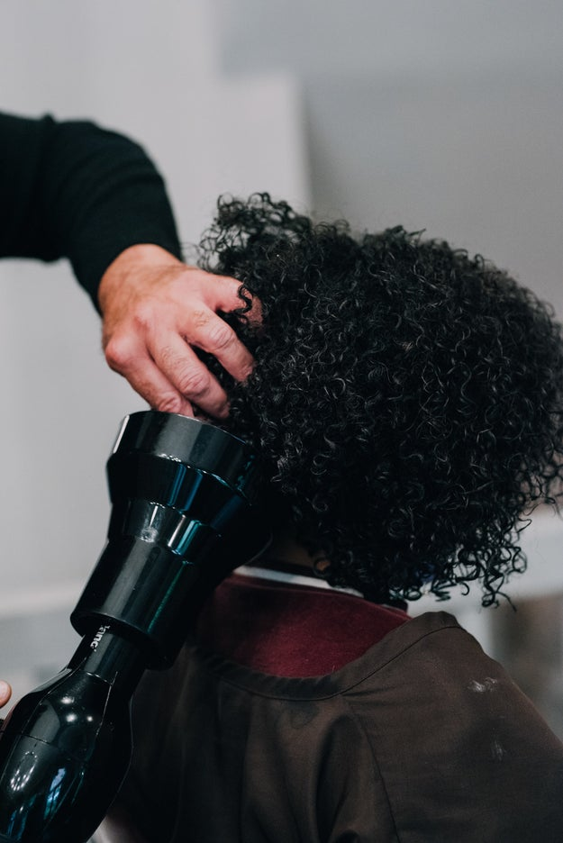 Air drying's cool, but it takes forever. Using a blow dryer with a diffuser attachment minimizes frizz and helps to maintain volume, giving curls an air-dried look in a fraction of the time.