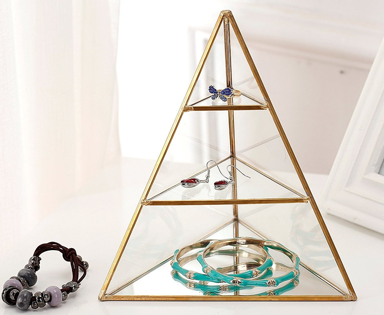 """Promising review: """"Brought this as a gift for my friend and she absolutely loves it!! It's open on one side and closed by glass on the other two. Perfect for her jewelry."""" —Jerry RhymeGet it on Amazon for $29.99."""