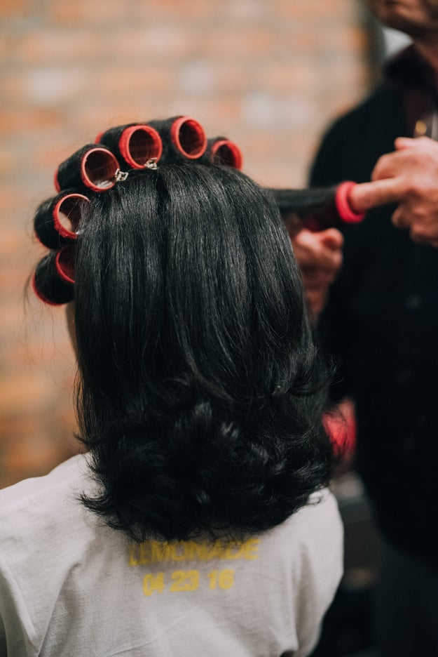 After all of the hair was curled and set, Andre carefully removed each roller, applied a bit of Q-oil, and vigorously brushed it through Natelege's tresses.