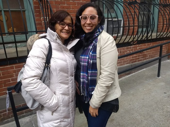 Evelyn Rosario and her daughter Emaline Delgado outside the hurricane resource center in Harlem.