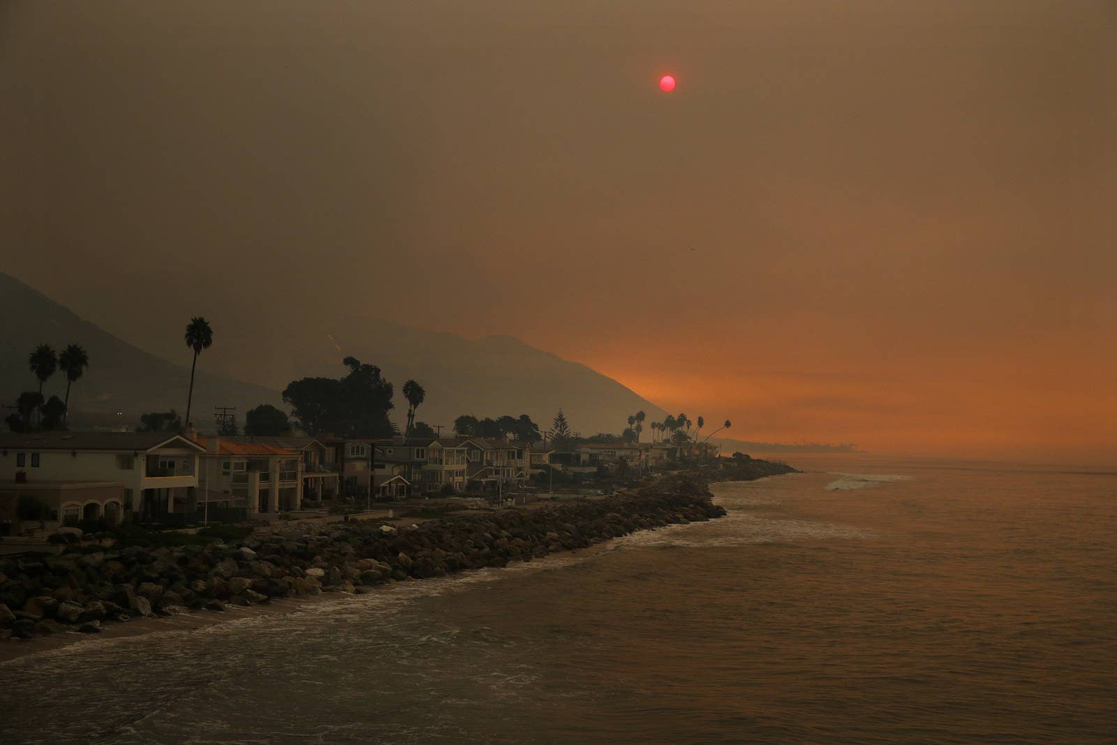 Thick Smoke Blankets Homes Along The Beach In Ventura