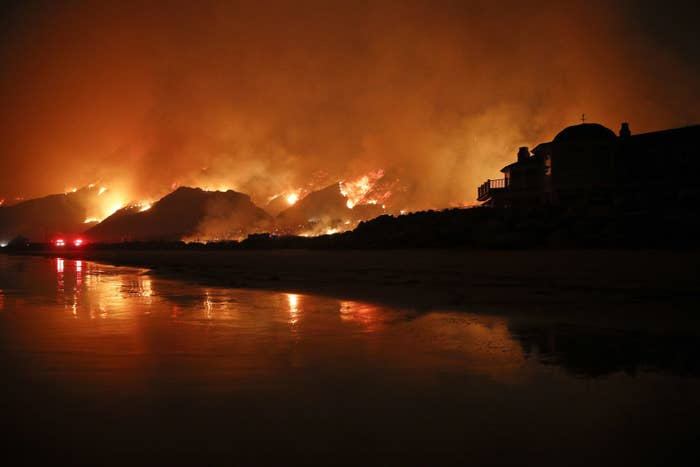 A wildfire burns along the oceanside 101 Freeway in Ventura.