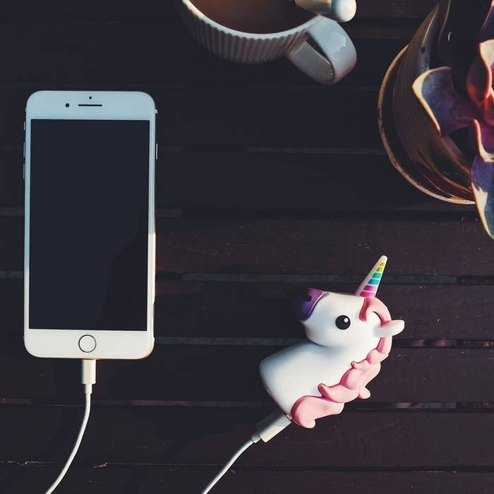 "It's hard to imagine a person receiving a unicorn phone charger, and not being happy about it – just saying 🦄.Compatible with iPhone/Android devices.Promising review: ""So my son mentioned he needed a new powerbank for his phone. I thought it would be funny to buy him this one. Its actually kinda cute. He loves it. It is easy to charge, using the included USB. Same with charging your phone, just plug it in."" –Amber BurtonGet it from Amazon for $16.99 (available in three different emojis)."
