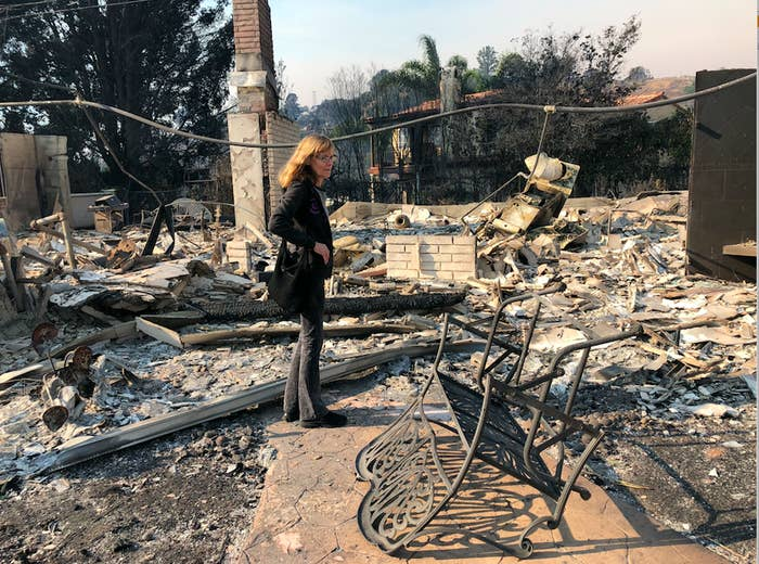 Pat Erickson stands near the front entrance of her home, which was destroyed in the Thomas Fire Monday night.