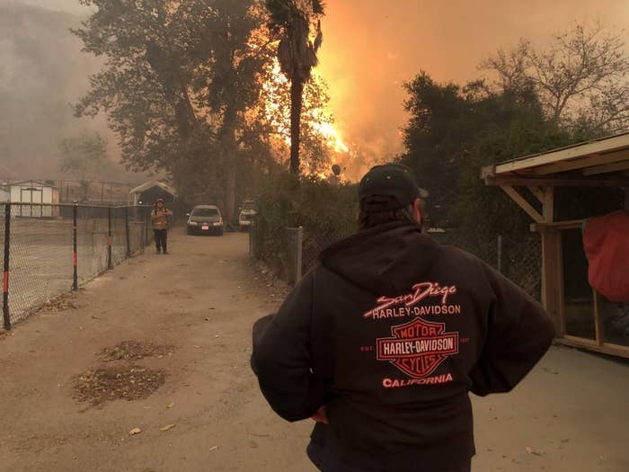 Jim Merriman watches as flames quickly approach his home in Ventura County, California.