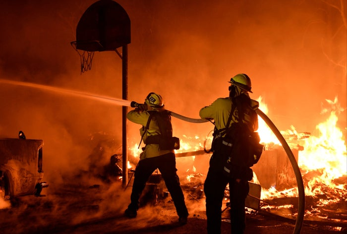 Firefighters battle flames in Santa Paula, California, on Monday.
