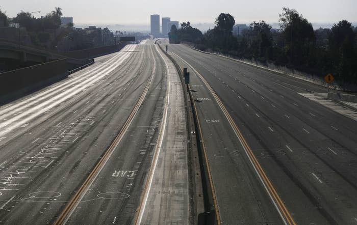 A stretch of Interstate 405 is closed to traffic during rush hour near the Skirball Fire on Dec. 6, in Los Angeles.