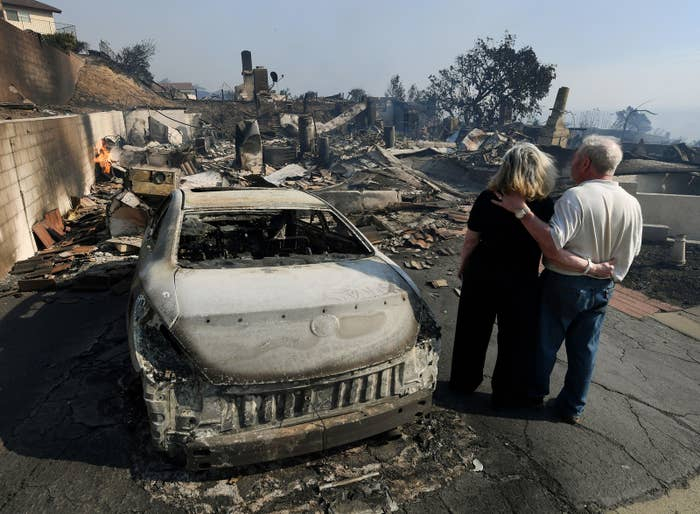 Michael and Vonea McQuillam survey the remains of their house, which was destroyed during the Thomas Fire in Ventura, California, on Dec. 5.
