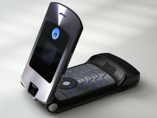 Photo of a half way opened dark grey Motorola Razr.
