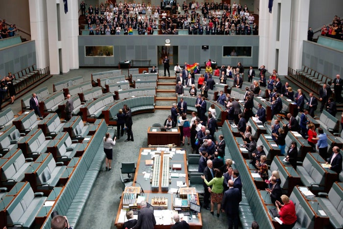 Politicians celebrate after voting to legalise same-sex marriage in Canberra on December 7, 2017.