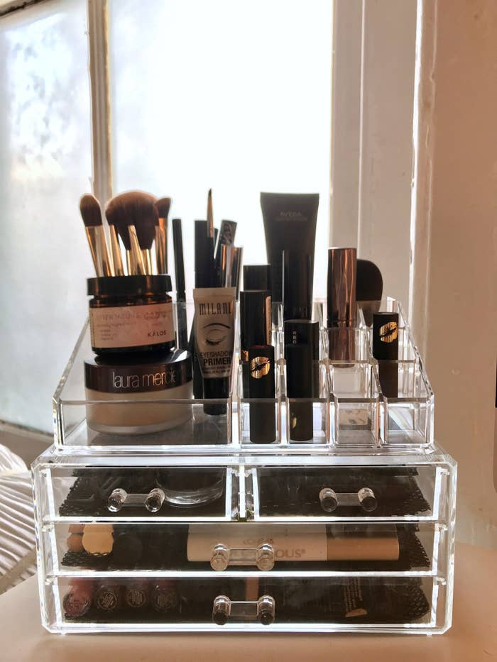 And let me tell ya, I LOVE IT. It holds all of the things I use daily, like my brushes, mascara, and lipsticks. The top part can easily be removed or left as is — it's up to you. This detachable feature means you can buy other pieces to expand the organizer and possibly make it a giant makeup tower. (Someone please do that!) The only downside is that the drawers are too small to hold some of my bigger palettes, but more on that later...