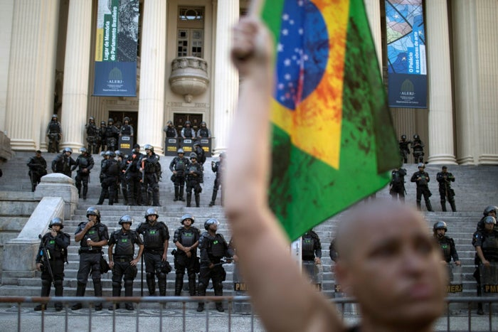 A demonstrator in front of riot police outside the state legislature in Rio de Janeiro, Brazil, on Nov. 17, 2017.
