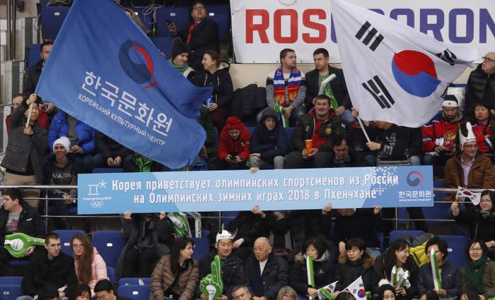 "Spectators at a hockey match in December held a placard that read, ""Korea welcomes Olympic athletes from Russia at the 2018 Winter Olympics in Pyeongchang."""