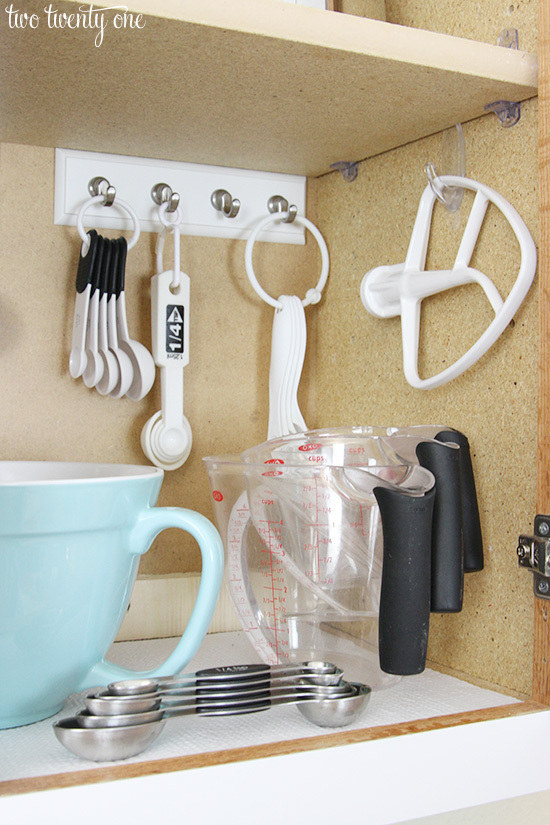 Maybe you want to show off your baking cabinet, with everything you need neatly hung on Command Hooks.