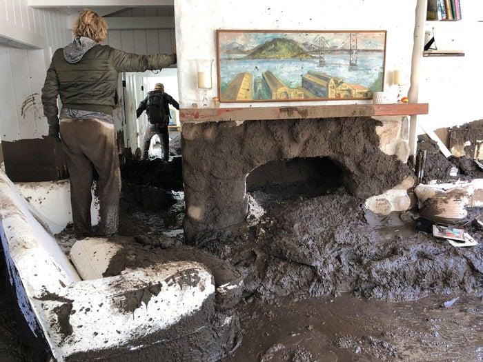 Family members inspect the inside of a Montecito, California, home Wednesday.