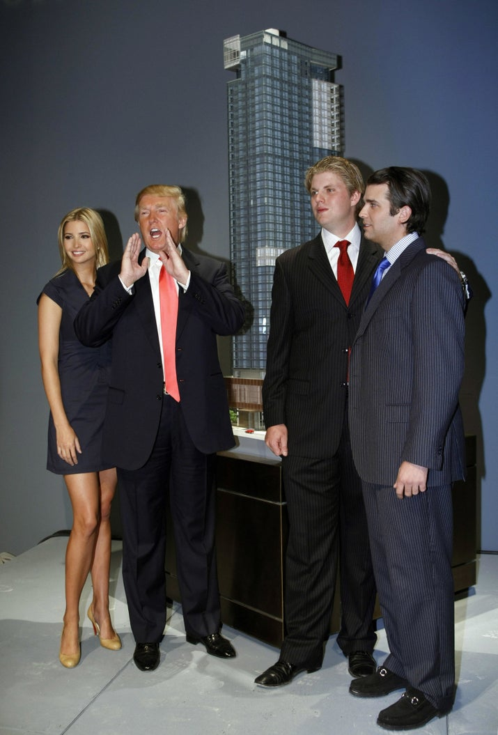 From left to right: Ivanka Trump, Donald Trump, Eric Trump, and Donald Trump Jr. pose for photos after a press conference, where their father Donald Trump announced the launch of Trump SoHo Hotel Condominium in New York in September 2007.