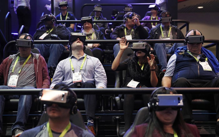 People look through Samsung Gear VR virtual reality goggles during CES International on Jan. 9, 2018.
