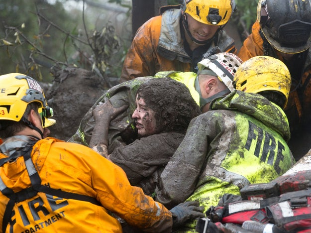 Emergency services, including firefighters assisted by helicopters, went house to house pulling people out of the mud.